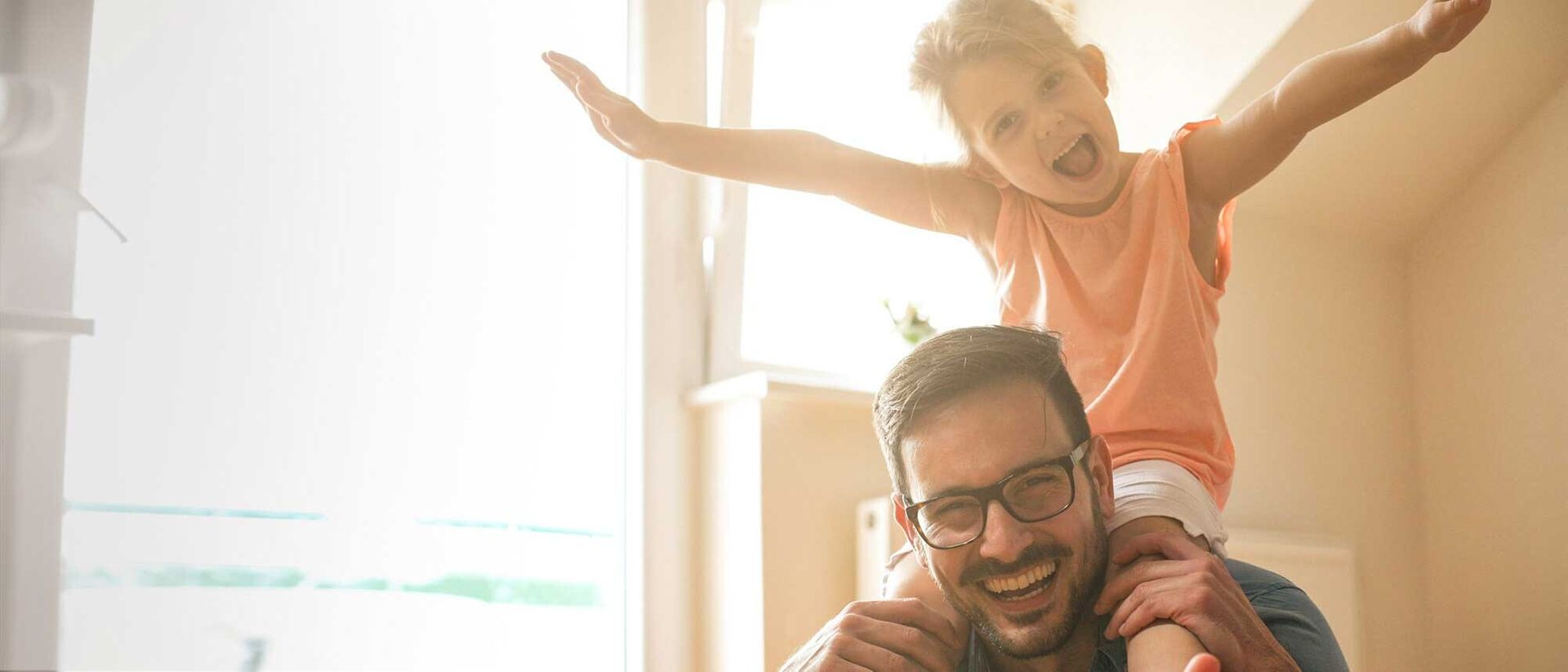 Freedom Mortgage: Young daughter on father's shoulders both laughing and smiling