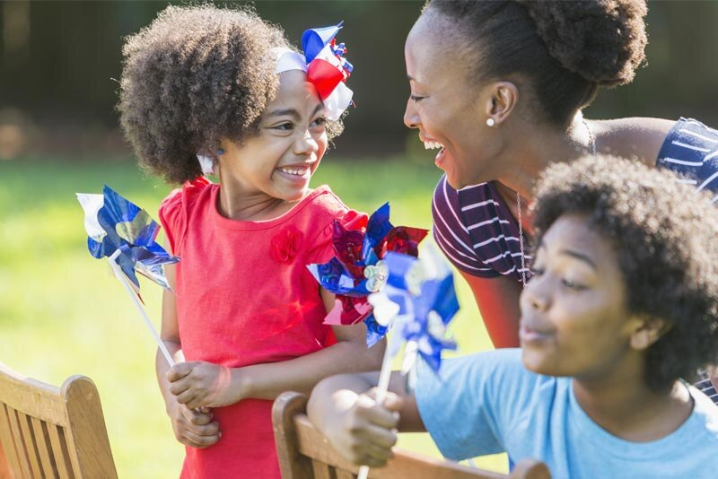 African-American mother outdoors with children
