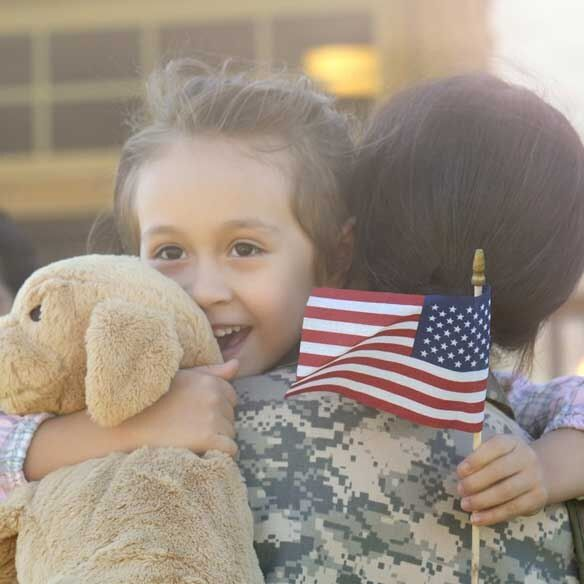 Young daughter hugs returning military mother