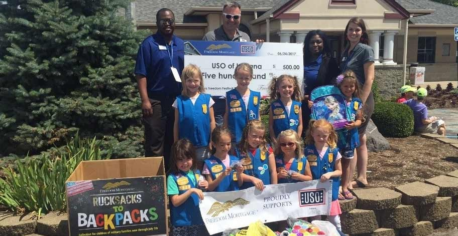 K'Shon Shonhai, Charles Ridings - USO Indiana Executive Director, Courtney Cook, Caitlyn Gilbert – Freedom Mortgage, members of Daisy Troop 03928