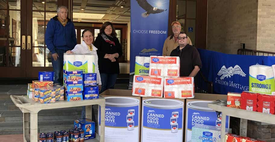 Melville, NY canned food drive Ryan Peterson right and members of ST. Elizabeths