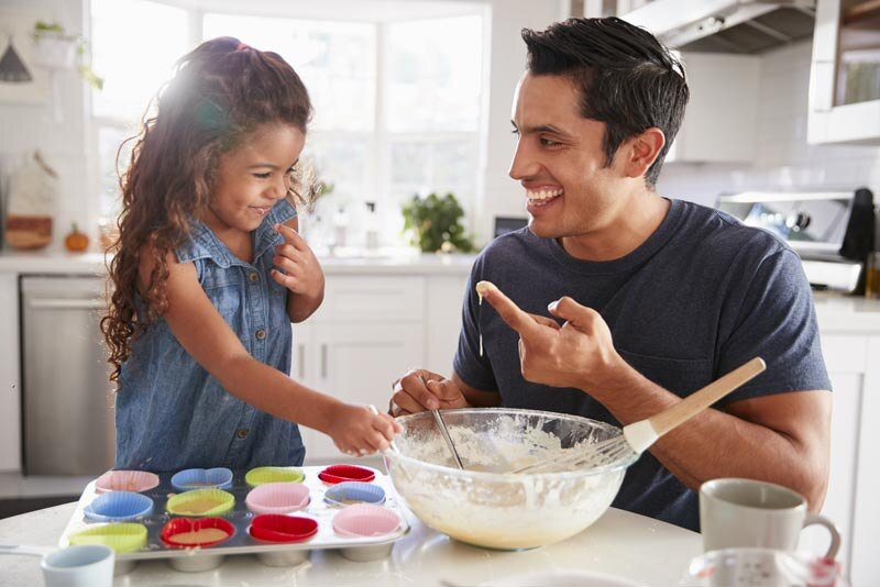 Father baking with daughter