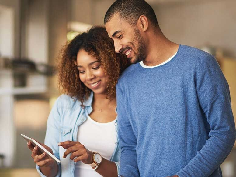 African-American couple looking at digital tablet