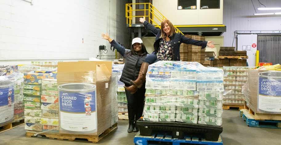 Team members delivering donations to Philabundance