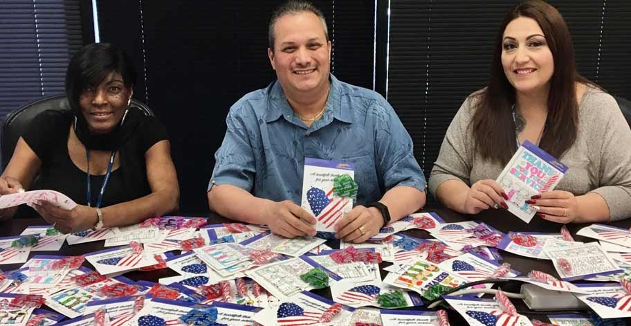 Felicia Washington, Guyray Chavez and Maggie Solano in San Dimas, CA filling their 161 candy grams with lollipops for the troops at the Bob Hope USO