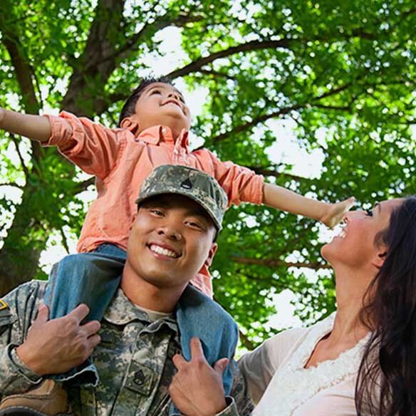 Military family of 3 outdoors