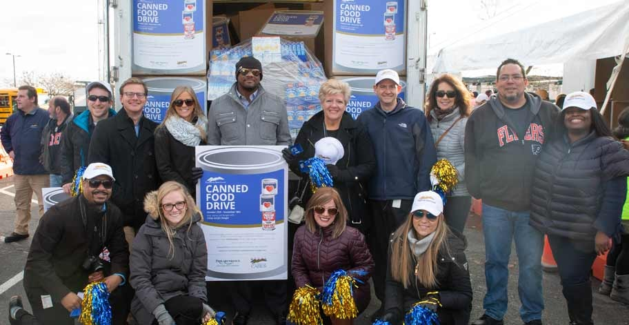 Team members delivering donations to Preston & Steve's Campout For Hunger