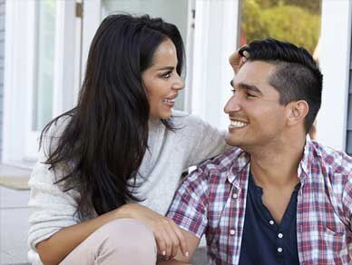Smiling couple on porch