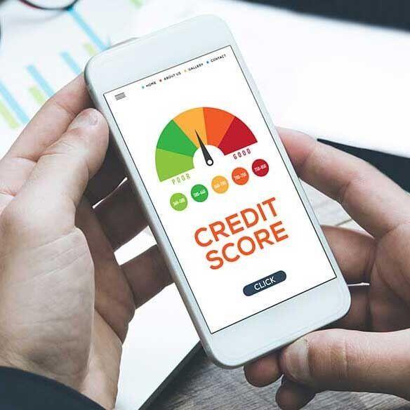 Image: Man checks credit score on mobile phone