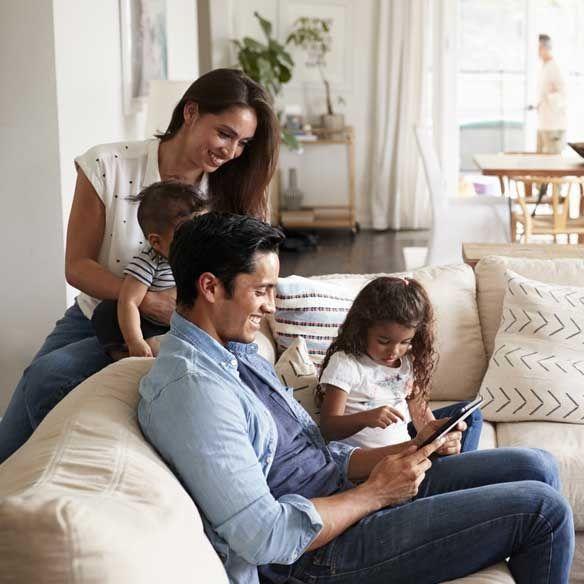 Asian family in living room