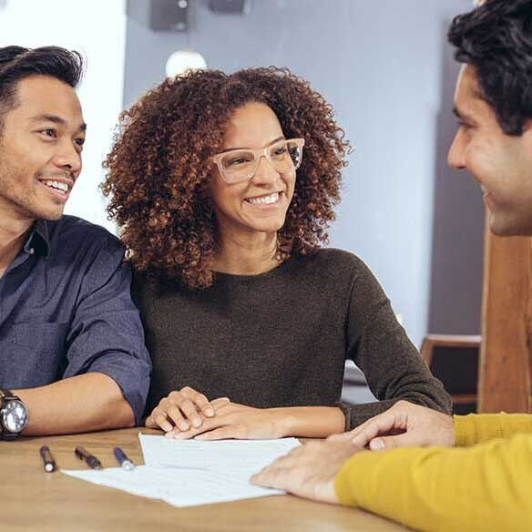 Multiracial couple talks with agent