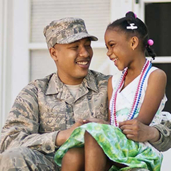 VA military father sits with daughter on porch
