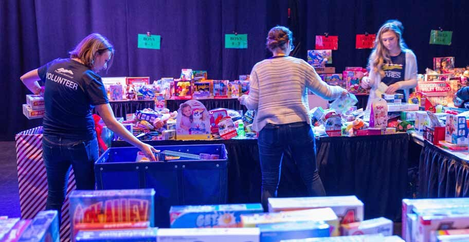NJ offices held a distribution event at the Salvation Army Kroc Center in Camden, bringing in their collection of over 1,535 toys for families to choose from.